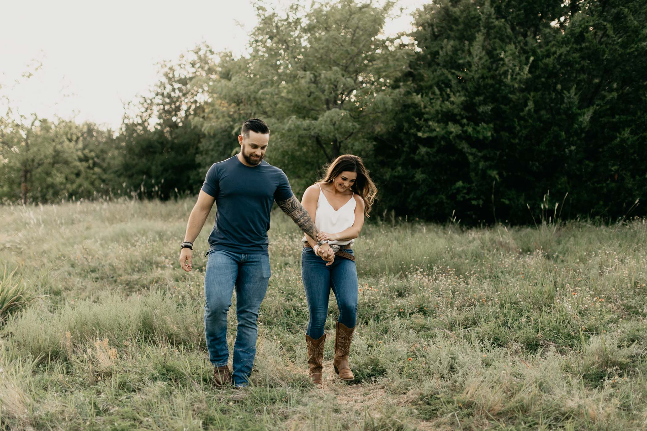 Playful couple taking engagement photos in Arbor Hills in Plano TX
