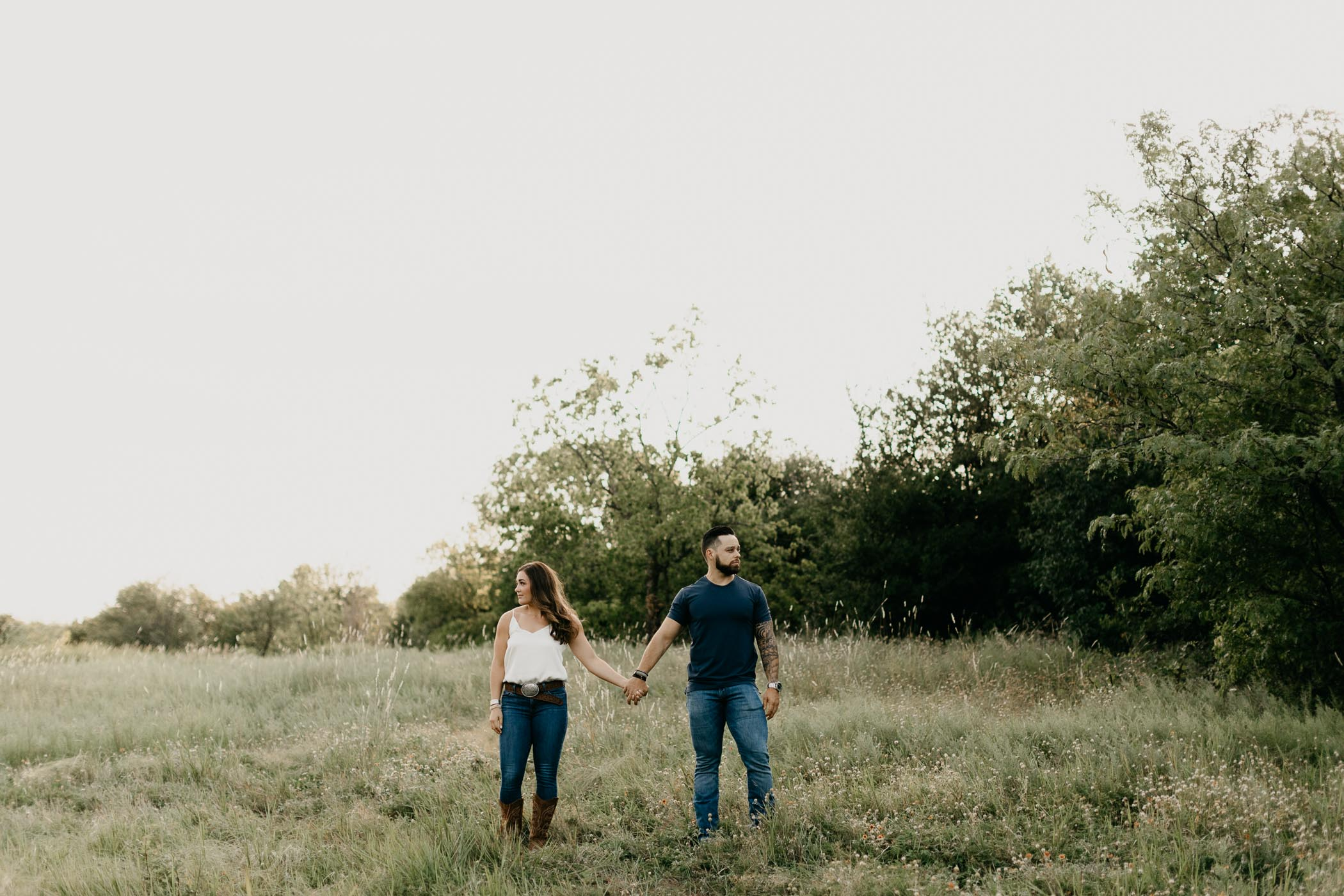 Moody engagement session pose in DFW