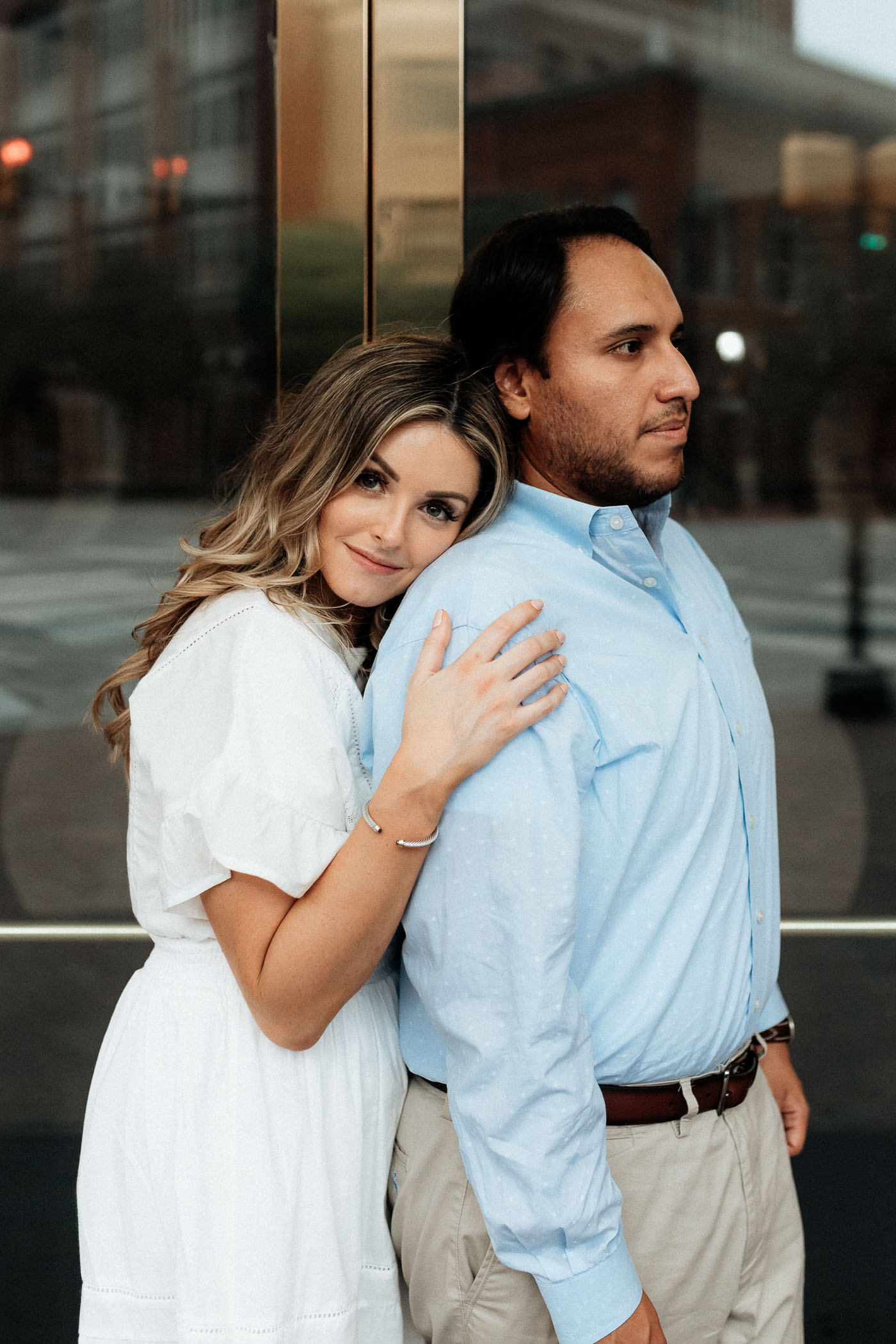 Romantic photo taking engagement photos in front of Bass Hall in Fort Worth