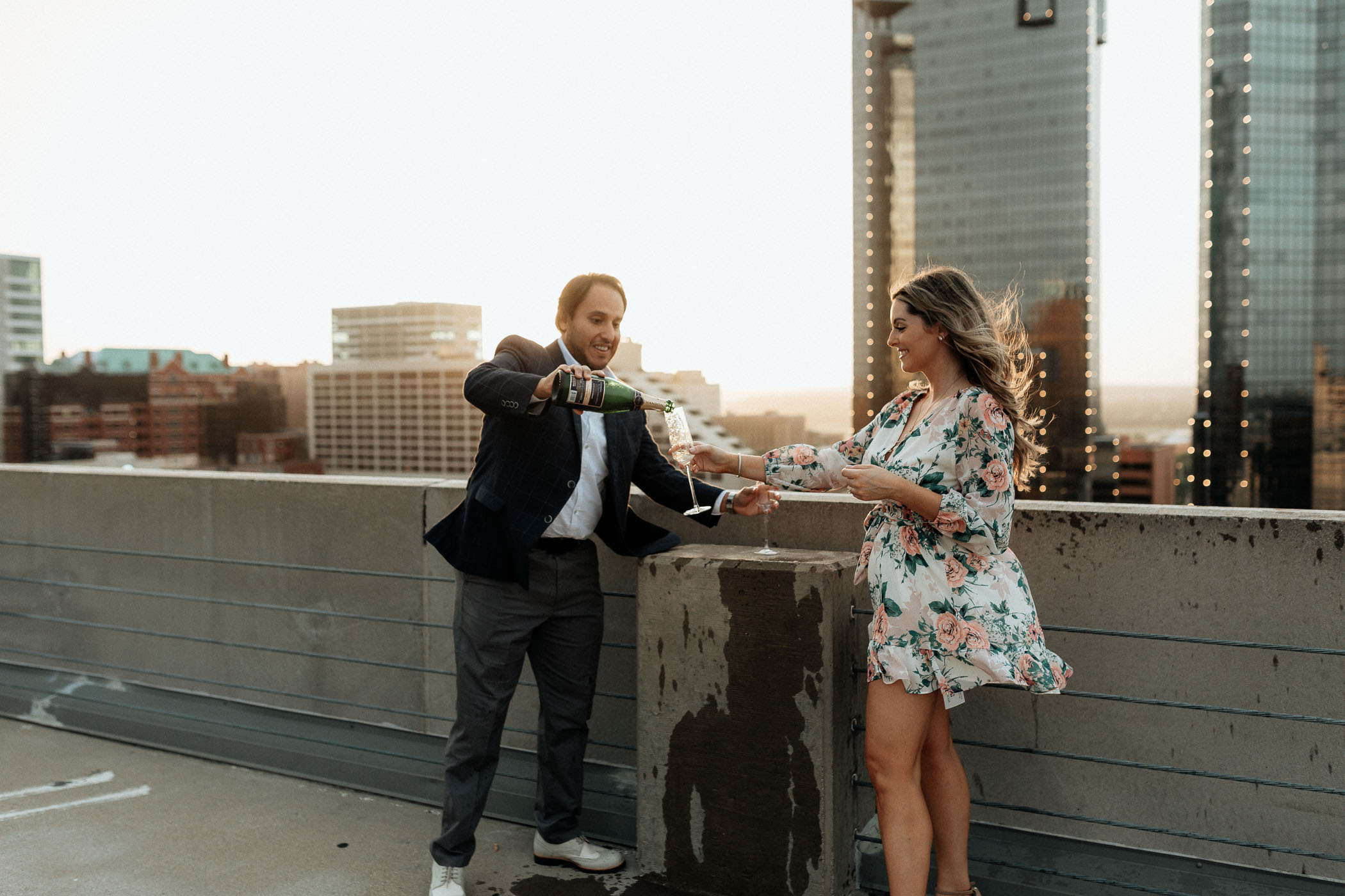 Couple drinking champagne on a rooftop in fort worth
