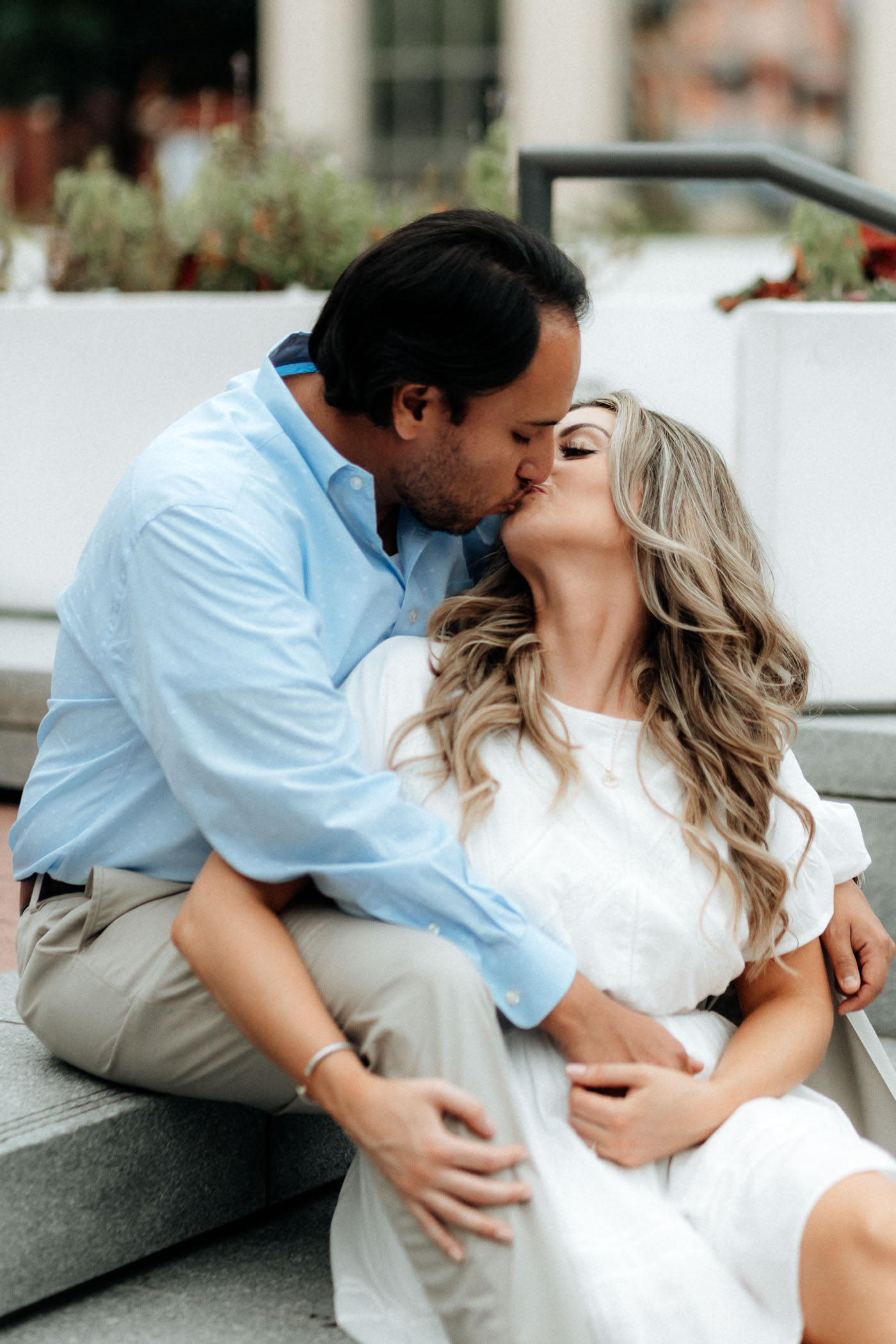 Couple kissing in DFW during engagement session