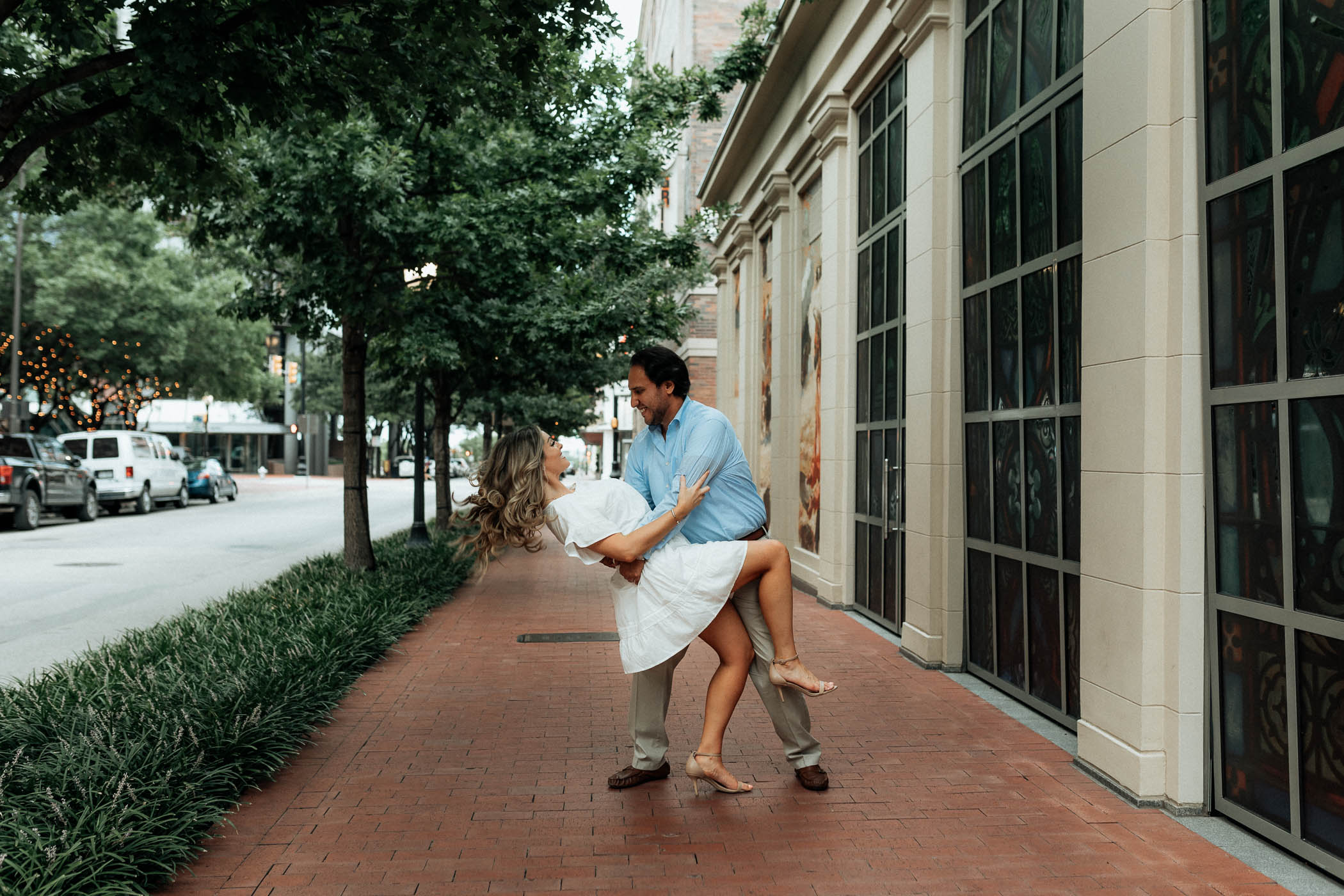 fiance dipping his girlfriend during downtown engagement session in DFW