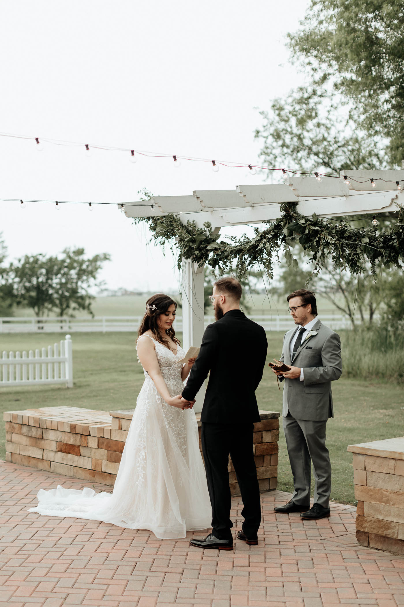 Bride reading her vows during Fort Worth wedding ceremony