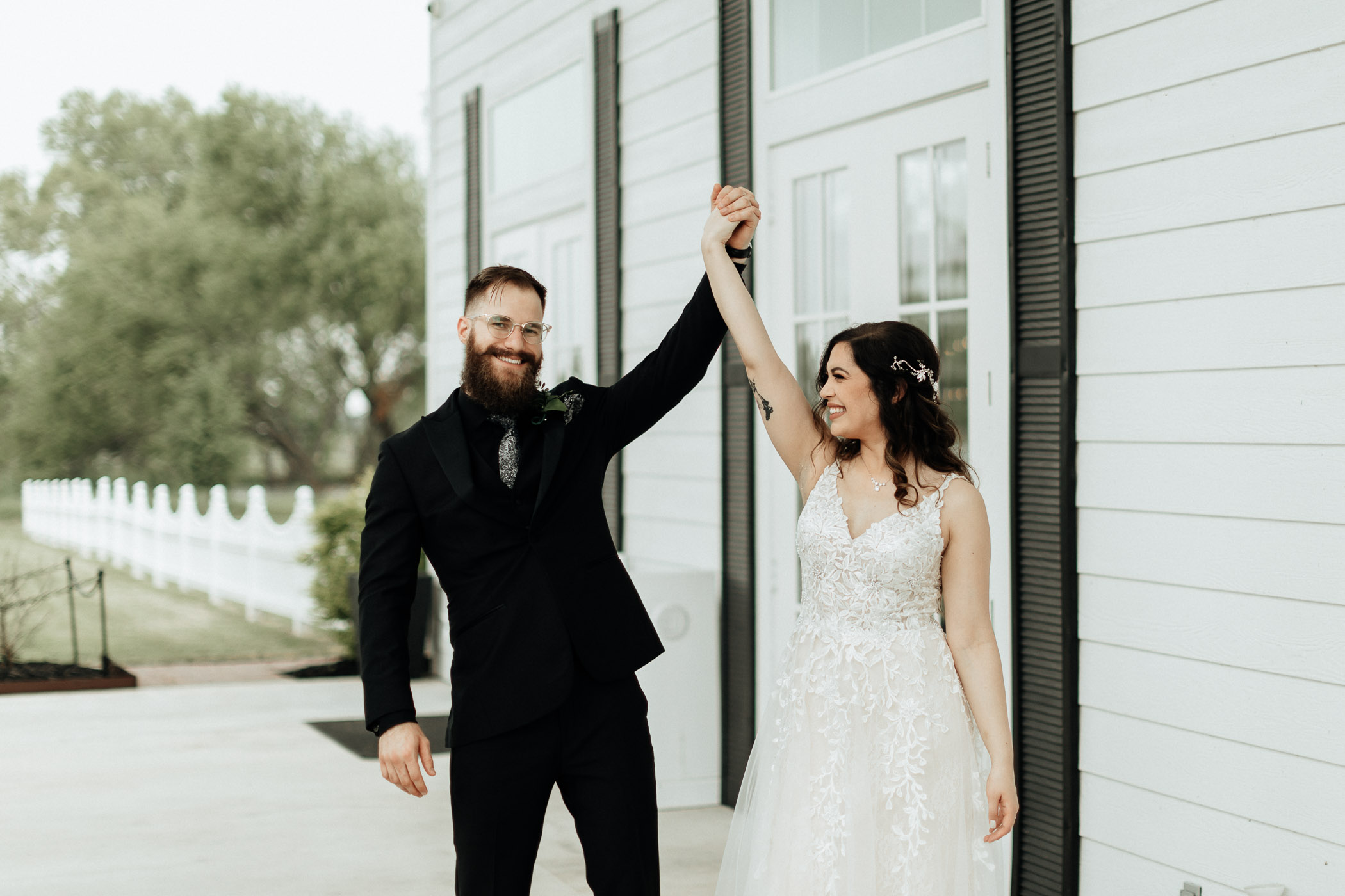 Bride and groom celebrating their recent wedding in DFW