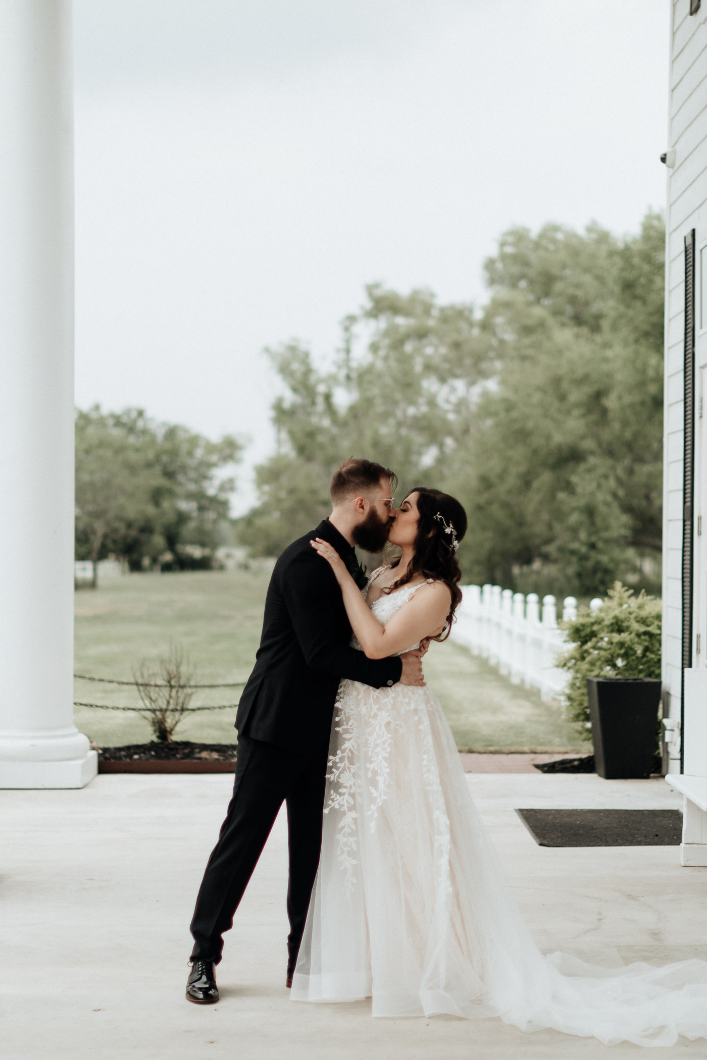 Bride and groom taking portraits after wedding ceremony in DFW