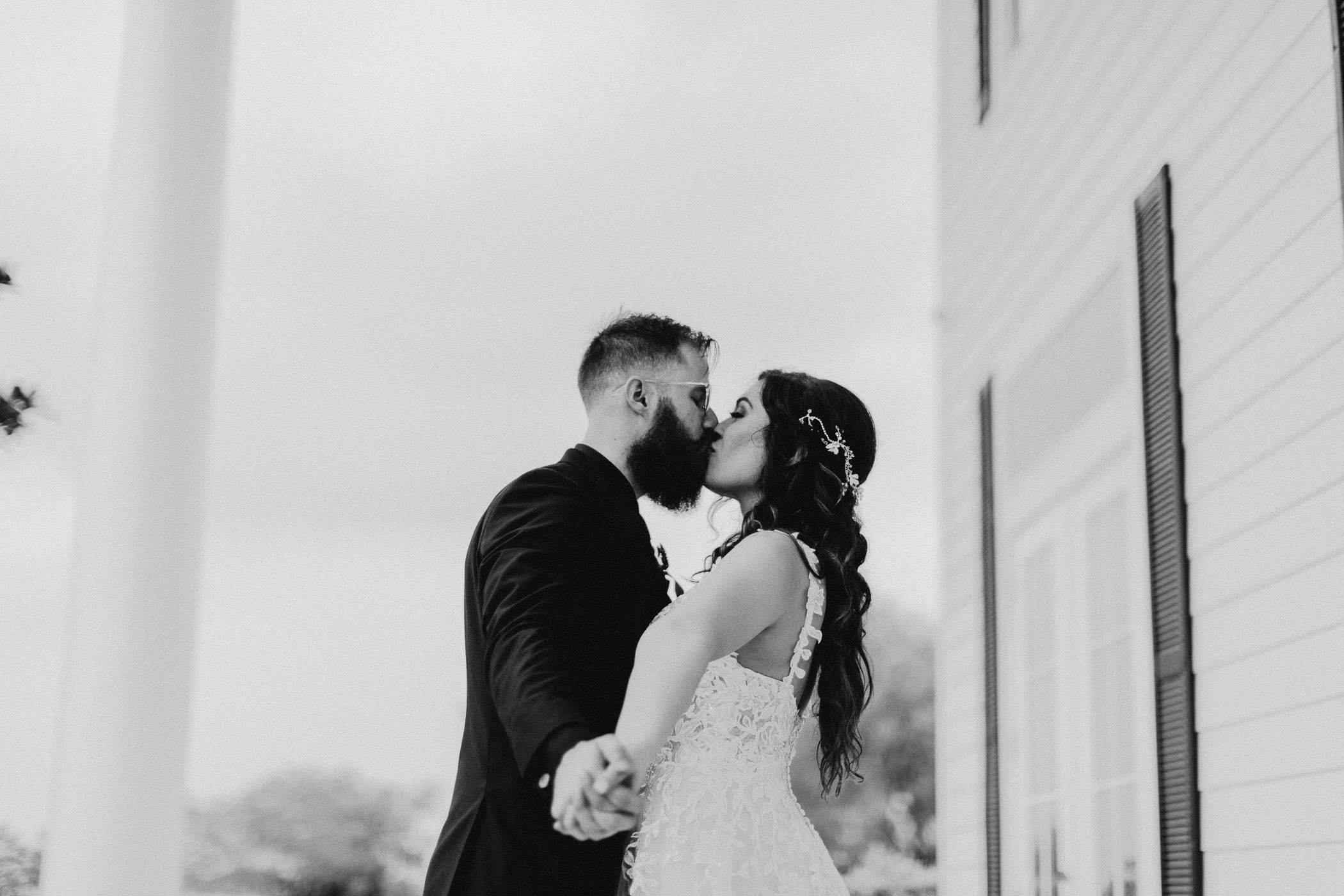 Black and white photo of bride and groom in DFW after wedding ceremony