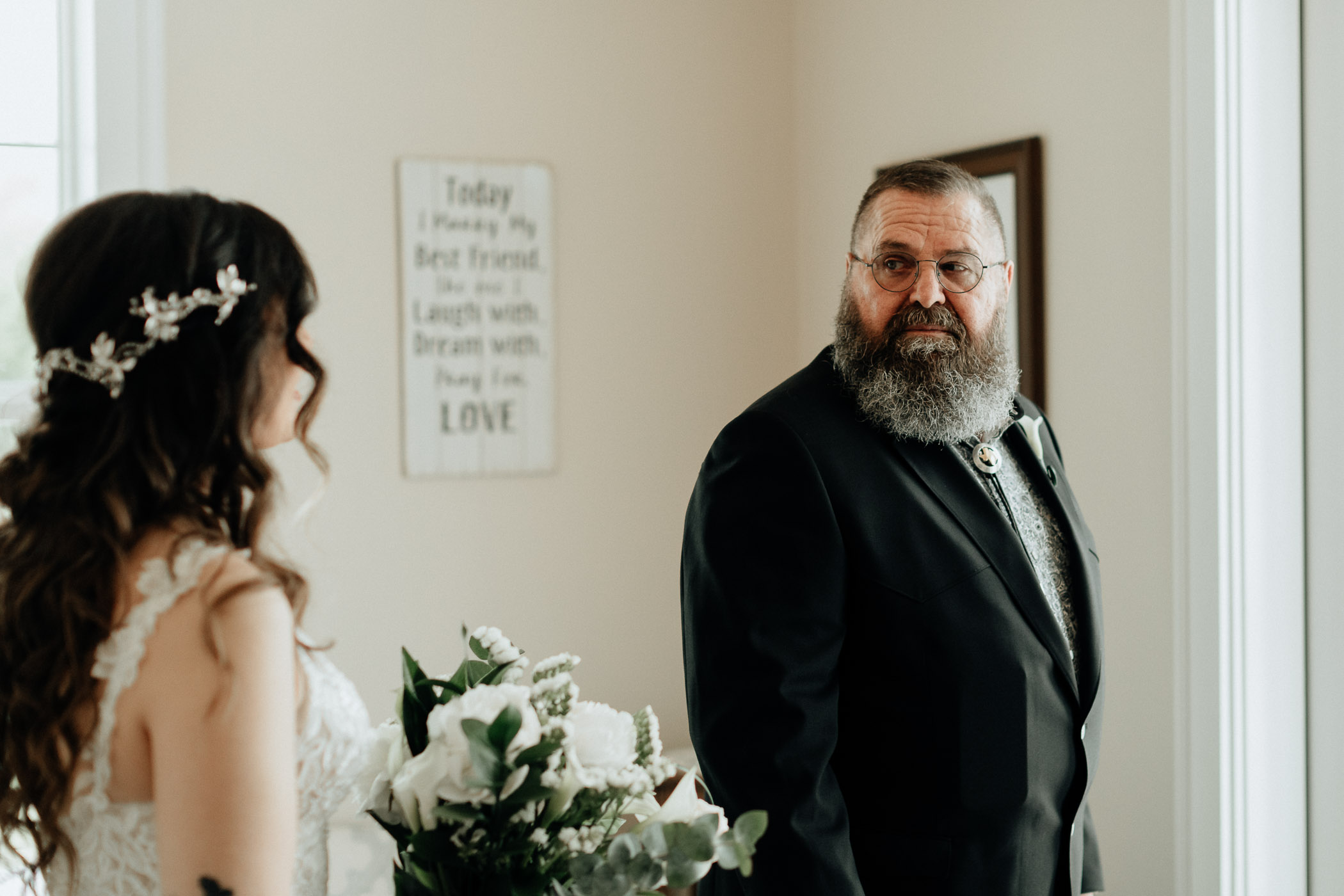 Bride seeing her dad for the first time on her wedding day