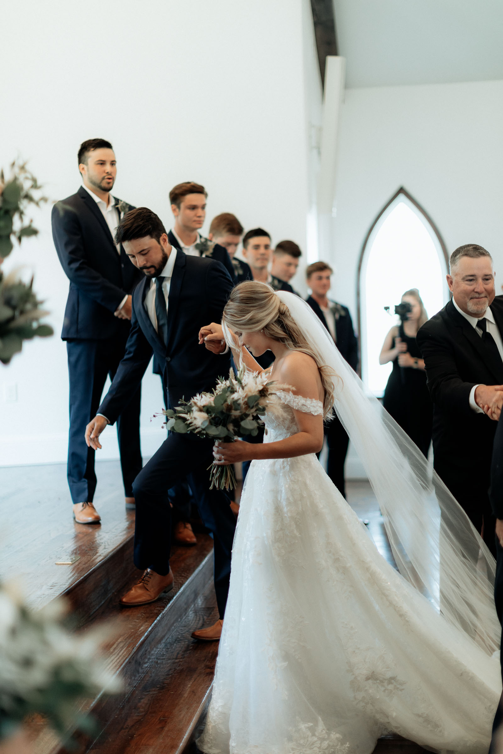 bride walking down the aisle with her dad on wedding day