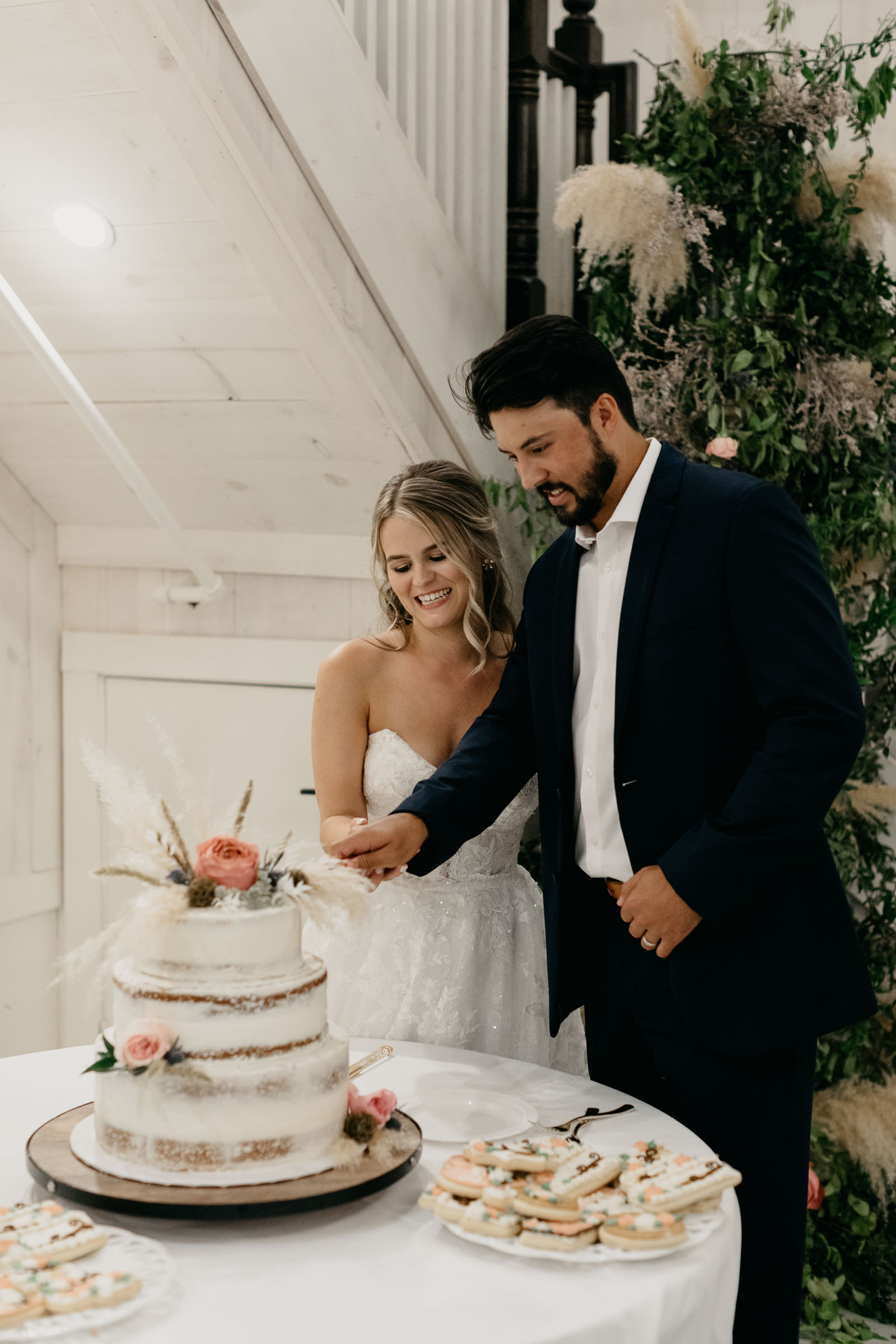 bride and groom cutting their wedding cake at one Preston events in DFW