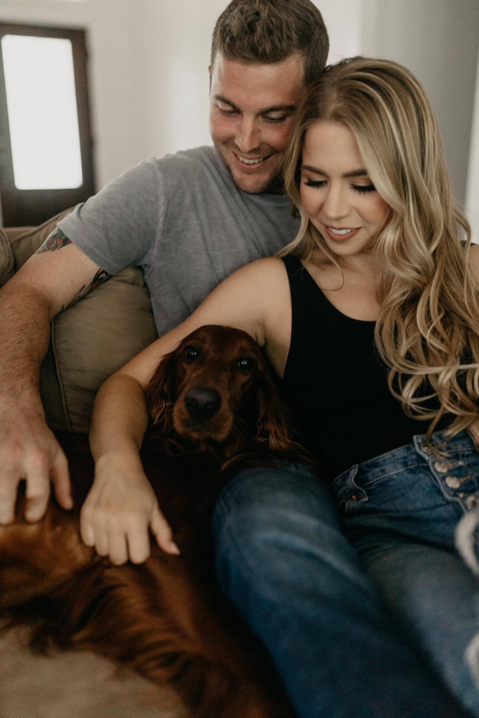 Cute dog getting attention during in home engagement session