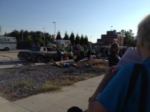 Car has driven into group at a garage sale