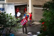 The behind-the-scenes look at some of Marist's student athletes unloading trucks into Leo Hall.