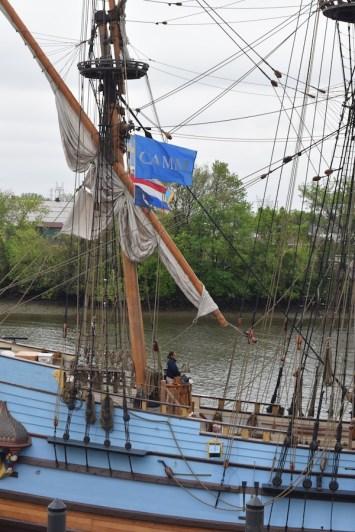 CAMM Banner flies above Captain Lauren Morgens on KALMAR NYCKEL