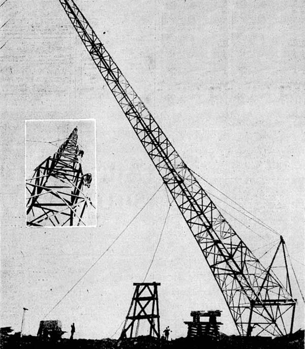 The first of six new steel tower-type masts which are being constructed at the Government wireless station on the top of Tinakori Hill was raised this morning by means of an electric winch, after waiting for some time for a windless day. It is 155ft high and weighs 9 1/2 tons. Inset, workmen scaling the mast to release the steel ropes used in pulling it into position.