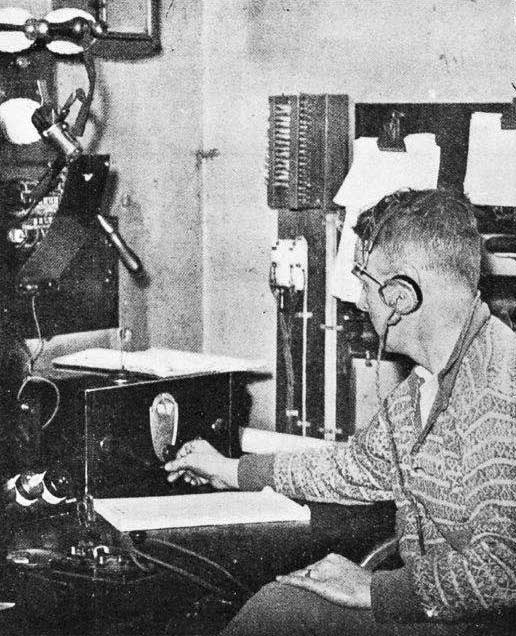 On duty at the Awarua Radio Station, near Invercargill. An operator listening at the receiving set for distress and other signals from shipping. This set is devoted solely for picking up messages from shipping. Auckland Weekly News, 17 July 1935.