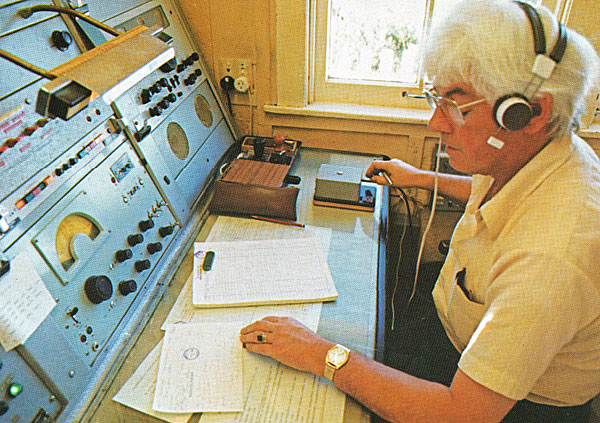 An operator on 500 kHz Morse at Wellington Radio ZLW