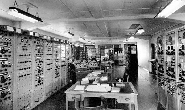 Main equipment room at Makara Radio, with Marconi receivers on the left and Hammarlund receivers on the right.