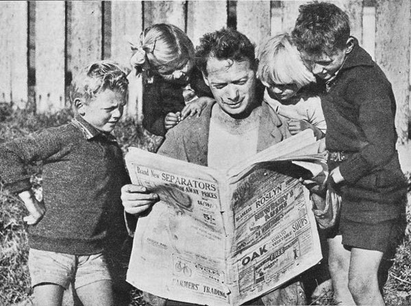 The Chief Lightkeeper at Cuvier Island reads the Auckland Weekly News, which arrives on the monthly supply boat