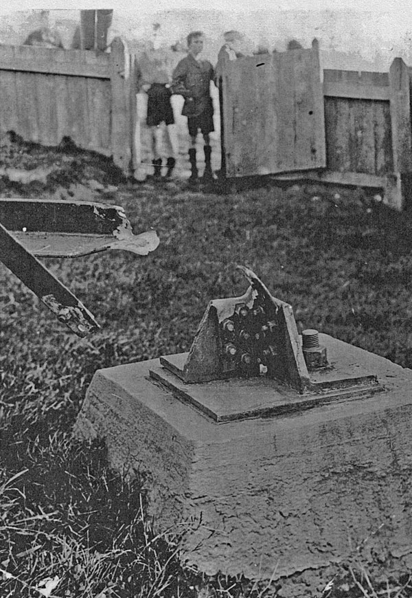 Children peer at the wreckage of the Wellington Radio tower blown down in 1926