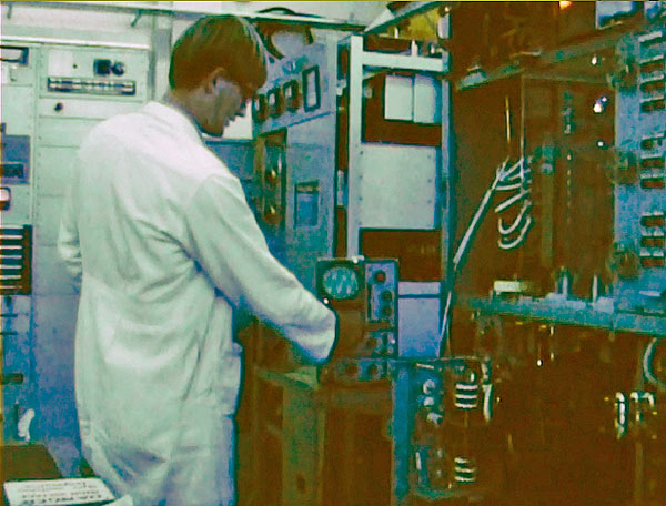 Technician Bill Jacob during commissioning of a 1 kW JRC single sideband transmitter for small ships service at Wellington Radio ZLW in 1970