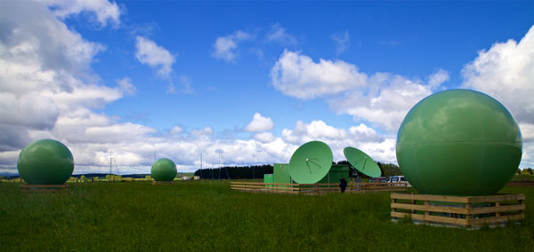 MEOSAR earth station (or MEOLUT) with the towers of Taupo Radio's receive site in the distance