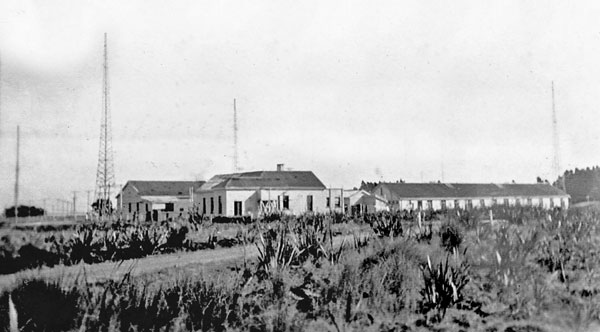 Awarua Radio ZLB in 1945, looking west. L-R: Original engine house (converted to transmitter hall), original operating building (converted to kitchen and dining room) and new dormitory