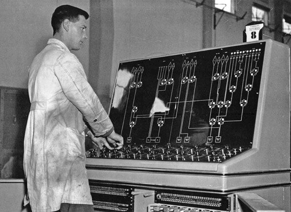 Neville Carwell Cooke at the aerial console