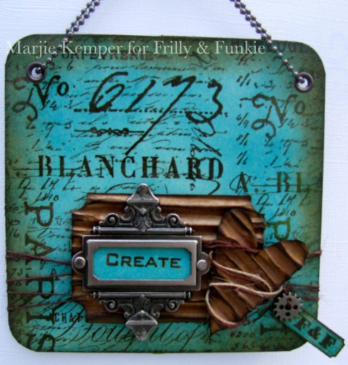 Wall hanging using a coaster, stamps, Sizzix dies and metal embellishments (Marjie Kemper)