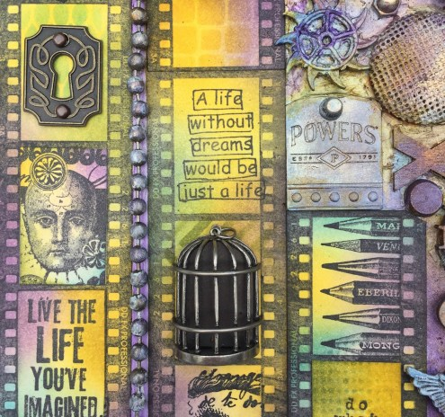 Mixed media art canvas close-up with Distress Inks and metal embellishments (Marjie Kemper)