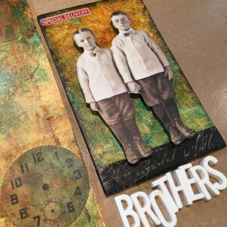 Collage elements from Tim Holtz on jumbo mixed media tag (Marjie Kemper)