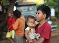 A Mangyan man and his child. (Photo Mark Ambay III)