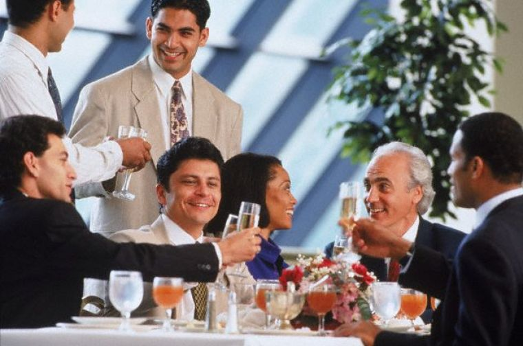 Business executives toasting success at lunch