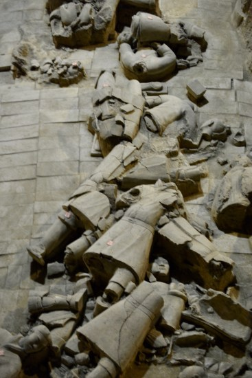 crumbled pieces of Shaanxi terracotta warriors being excavated for restoration
