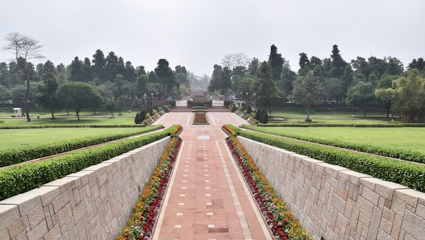 Raj Ghat - Gandhi - Gandhi memorial - New Delhi - entrance walkway with beautiful flowers