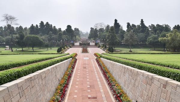 Raj Ghat - Gandhi - Gandhi memorial - New Delhi - entrance walkway with beautiful flowers