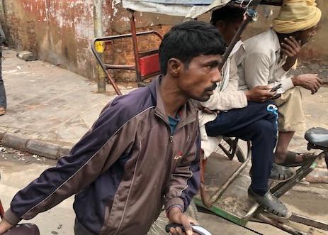 Mark and Chuck's Adventures - bicycle rickshaw - bicycle rickshaw in Chandni Chowk - Old Delhi - Chandni Chowk - streets of Delhi - India travel - India vacation - rickshaw driver pushing rickshaw