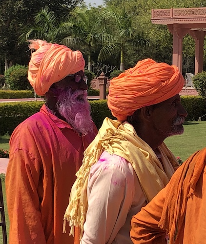 Mark and Chuck's Adventures - India Trip - Traveling in India - Traveling in India during Holi - Traveling in India during COVID 19 - locals celebrating Holi with resort guests - Umaid Lake Palace