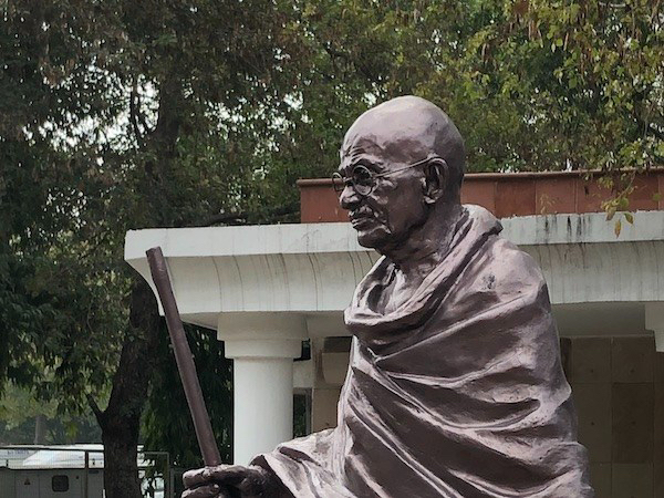 Mark And Chuck's Adventures - Raj Ghat - Mahatma Gandhi - India travel - statue of Mahatma Gandhi