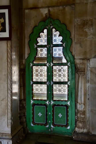 green wooden doors over the carved white marble screens - Jaswant Thada – Jodhpur – Rajasthan – India – traveling in India