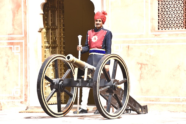 guard standing with a cannon - Jaipur City Palace - India
