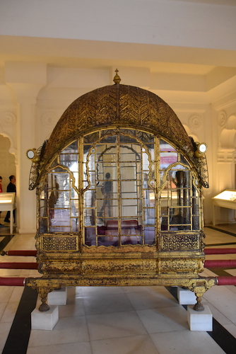 Palanquin - hand carried litter - gold palanquin - -Mehrangarh Fort – Jodhpur – Rajasthan – India – India travel blog – traveling in India