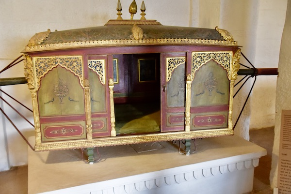 palanquin - hand carried litter - -Mehrangarh Fort – Jodhpur – Rajasthan – India – India travel blog – traveling in India