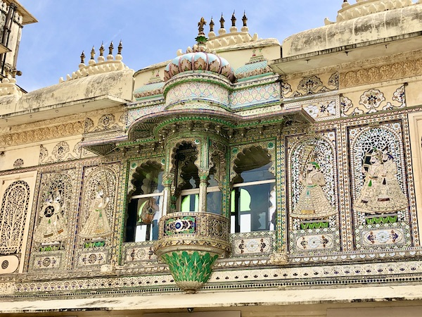 beautifully decorated upper floor balconies from the courtyard of the Udaipur City Palace