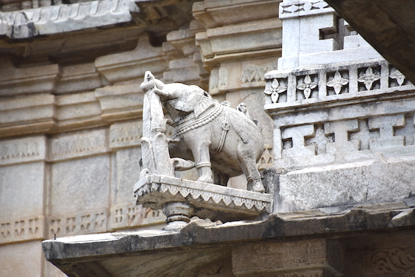 Carved elephant adorning the roof of the temple