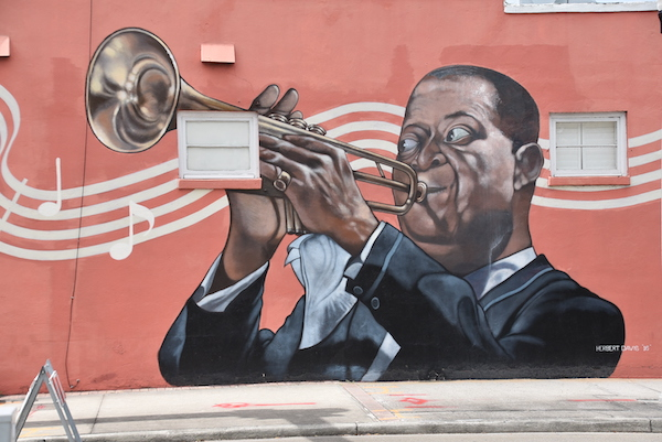 mural of Louis Armstrong playing a trumpet on Chief's Creole Cafe