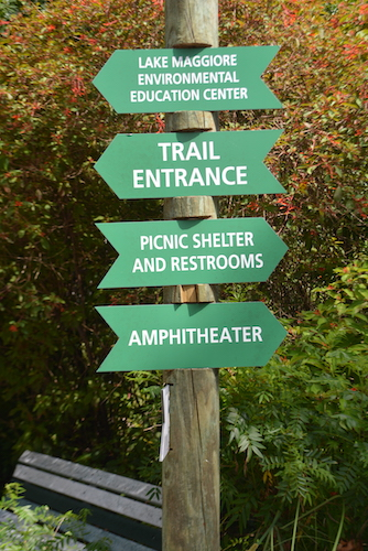 green directional signs at Boyd Hill Nature Preserve in St Petersburg Florida