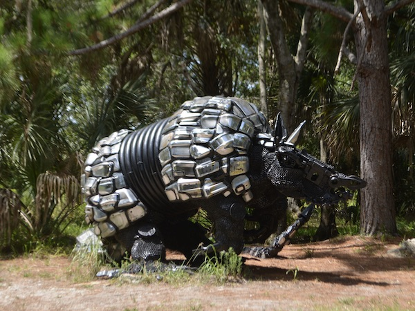sculpture of an armadillo made from car parts