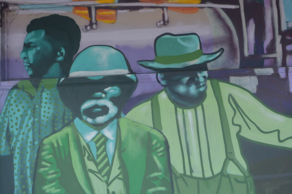 older black men are part of a Saint Petersburg meal by artist Zulu