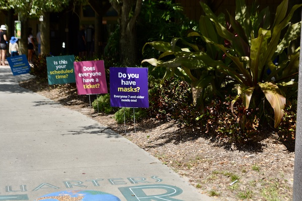 signs explaining the Brevard Zoo's COVID-19 guidelines