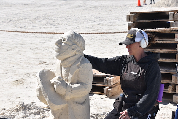 sculptor working on an exhibit piece at Treasure Island Florida's Sanding Ovation